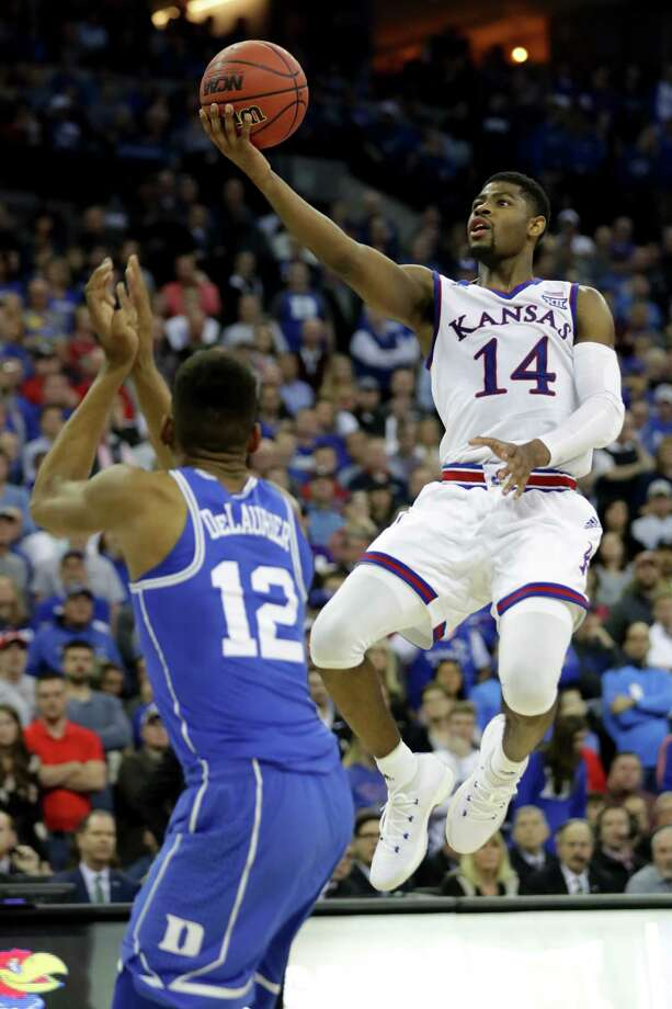 OMAHA, NE - MARCH 25:  Malik Newman #14 of the Kansas Jayhawks shoots the ball against Javin DeLaurier #12 of the Duke Blue Devils during overtime in the 2018 NCAA Men's Basketball Tournament Midwest Regional at CenturyLink Center on March 25, 2018 in Omaha, Nebraska.  (Photo by Streeter Lecka/Getty Images) Photo: Streeter Lecka / 2018 Getty Images