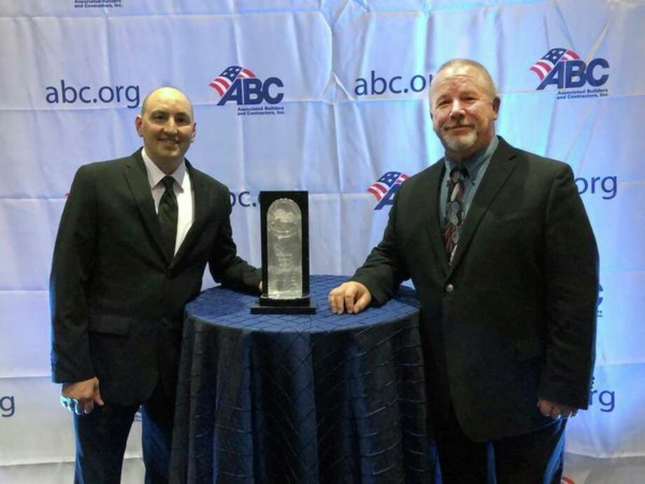 Three Rivers Corp., represented by Jeremy Sampson, left, and Paul Crivac, receive the Associated Builders and Contractors' National Safety Merit Award in the Commercial and Institutional Building Construction category. (Photo provided)