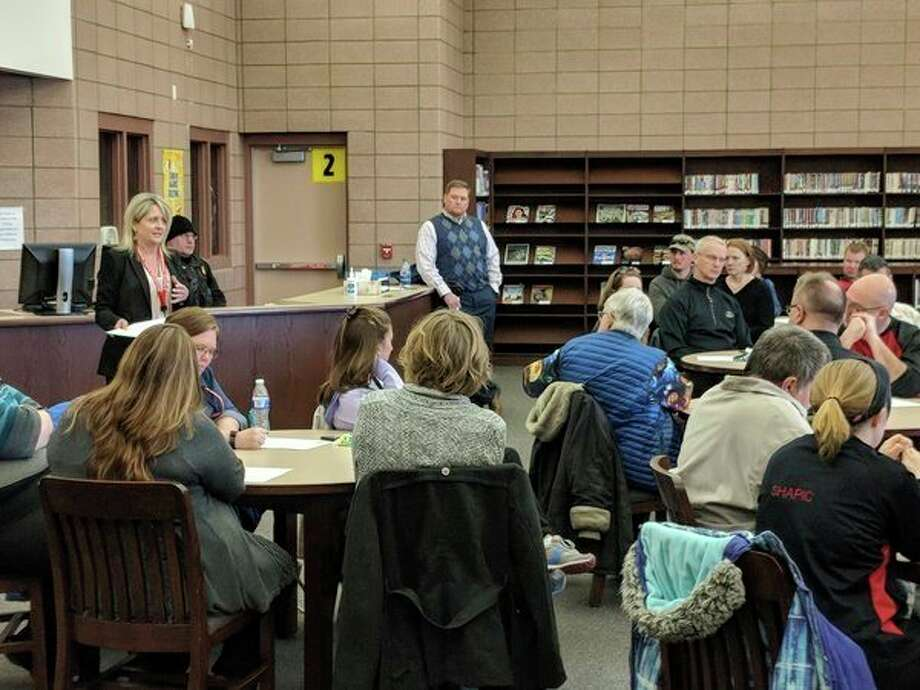 Beaverton Rural School Superintendent Susan Wooden (standing, far left) addresses the community late last week during a Safe and Secure Schools Community forum. (Tereasa Nims/For the Daily News)
