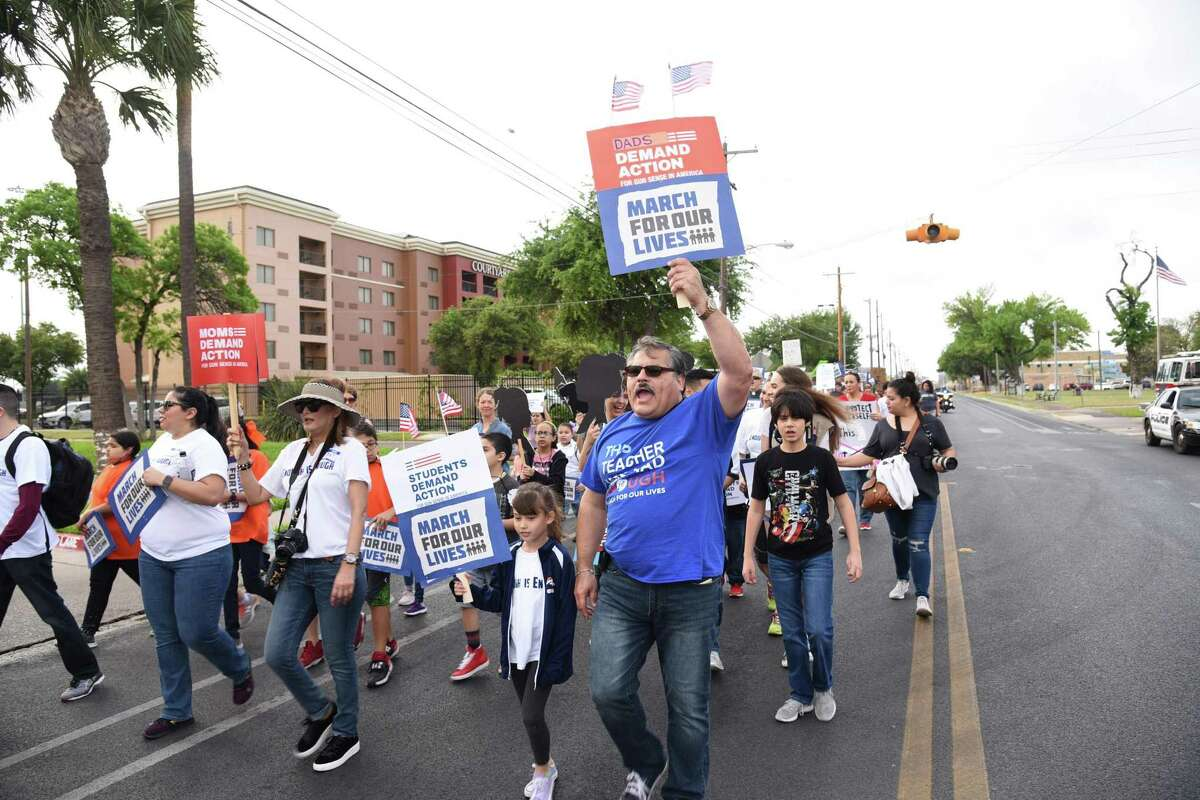 Marchers chant and raise their signs during the March For our Lives on San Bernardo Avenue on Saturday.