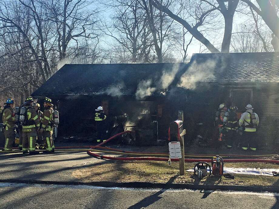 A fire that broke out of an attached garage at 82 Poplar St. in Trumbull on Monday, March 26, 2018. The fire heavily damaged the garage and a portion of the ranch-style house Photo: Sophia Kunthara /Hearst Connecticut Meda