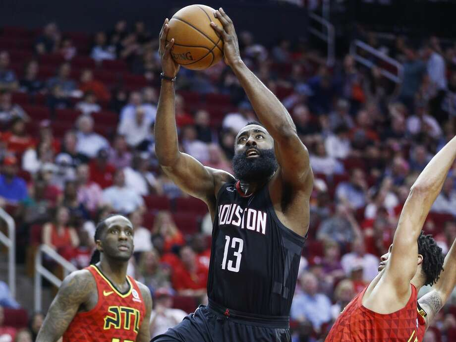 Houston Rockets guard James Harden (13) takes a shot over Atlanta Hawks guard Damion Lee (8) during the second half as the Houston Rockets take on the Atlanta Hawks at the Toyota Center Sunday, March 25, 2018 in Houston. (Michael Ciaglo / Houston Chronicle) Photo: Michael Ciaglo/Houston Chronicle