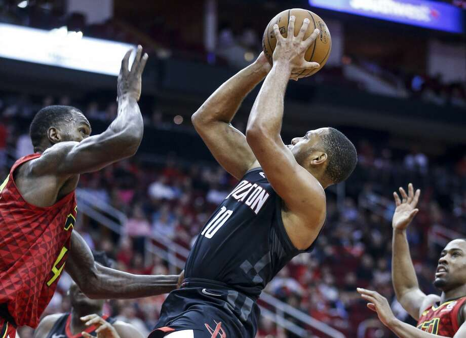 Houston Rockets guard Eric Gordon (10) takes a shot over Atlanta Hawks center Dewayne Dedmon (14) as he drives to the basket during the second half as the Houston Rockets take on the Atlanta Hawks at the Toyota Center Sunday, March 25, 2018 in Houston. (Michael Ciaglo / Houston Chronicle) Photo: Michael Ciaglo/Houston Chronicle