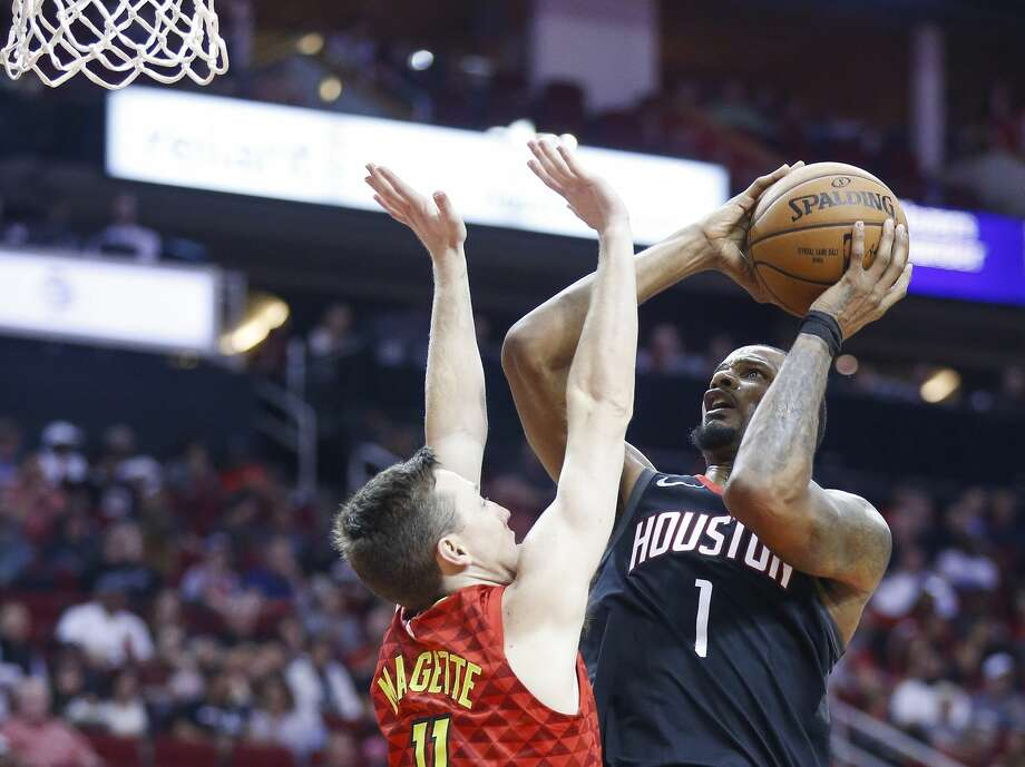 Houston Rockets forward Trevor Ariza (1) takes a shot over Atlanta Hawks guard Josh Magette (11) during the second half as the Houston Rockets take on the Atlanta Hawks at the Toyota Center Sunday, March 25, 2018 in Houston. (Michael Ciaglo / Houston Chronicle) Photo: Michael Ciaglo/Houston Chronicle
