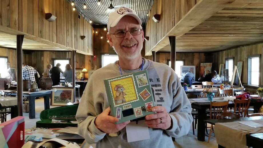 "Creator Denis Williamson exhibits the ""Mystery Puzzle Box"" treasure-hunt journey package. Photo: N.F. Ambery / Hearst Connecticut Media"