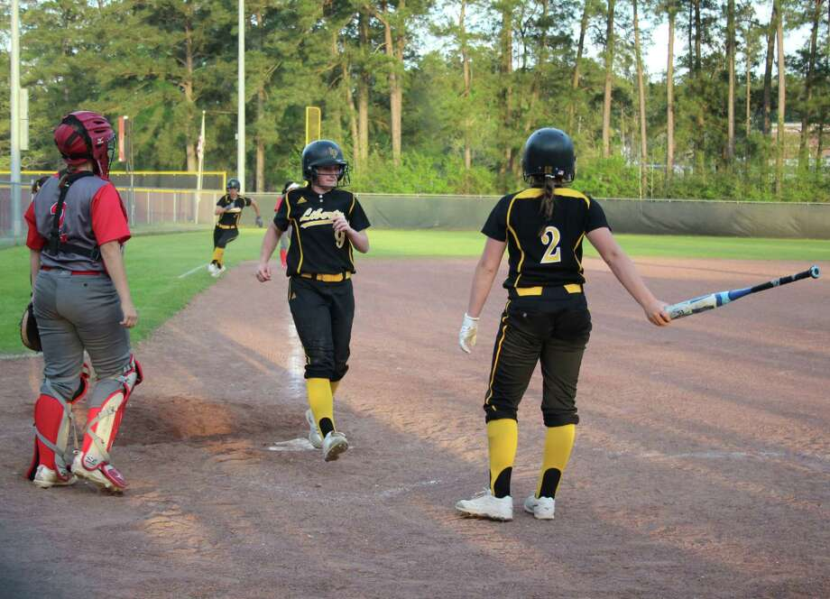 Liberty Lady Panther Jaylen Prichard (2) watches as teammates Harley Davis (7) and Kaci West (9) follow her to score a total of three runs during the March 23 softball game against the Cleveland Lady Indians. Photo: Jacob McAdams