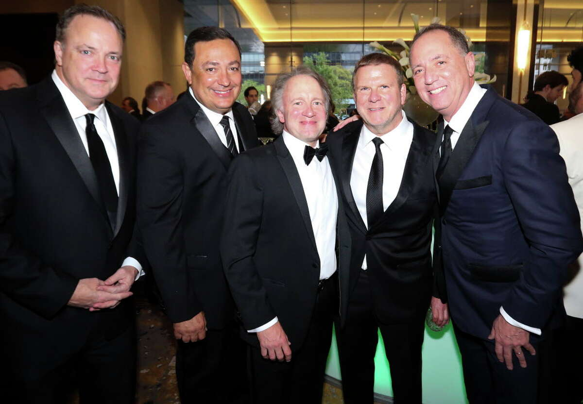 Tad Brown, from left, Houston Police Chief Art Acevedo, Dave Jacquin, Tilman Fertitta and Rich Handler pose for a photograph at the Houston Children's Charity 21st Annual Gala at Post Oak Hotel on Friday, March 23, 2018, in Houston.