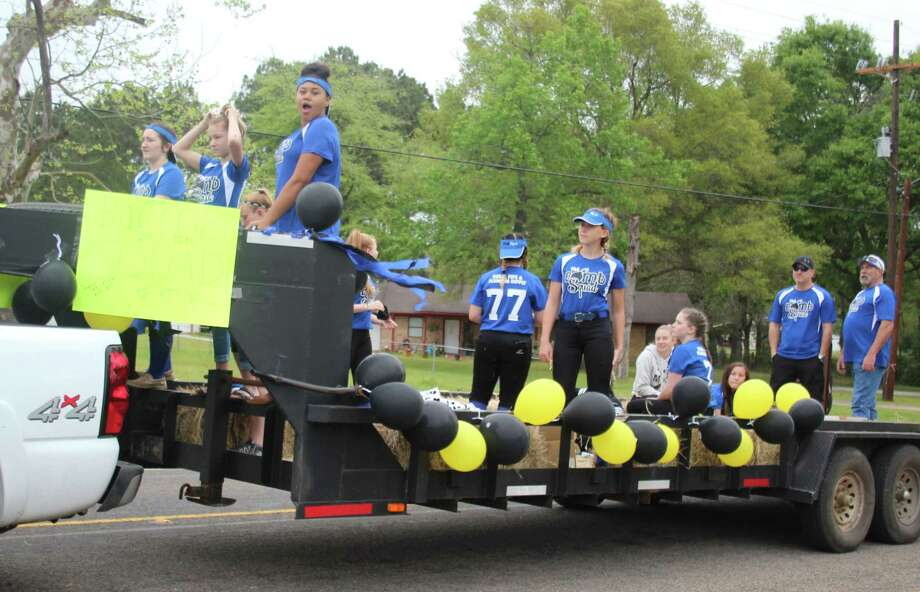 The Bomb Squad softball team receives praise from local Shepherd citizens at the March 24 Shepherd Youth League Parade. Photo: Jacob McAdams