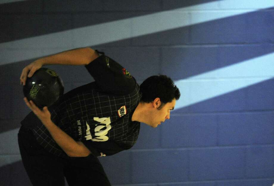(RM) DENVER ,CO--FEBRUARY 18TH 2009-- Professional bowler, Jason Belmonte from Australia bowls during the Professional Bowlers Association, PBA Tour Qualifying at the Brunswick Zone in Wheat Ridge Thursday morning. THE DENVER POST/ ANDY CROSS Photo: ANDY CROSS, STAFF / DP / (C) 2008 THE DENVER POST