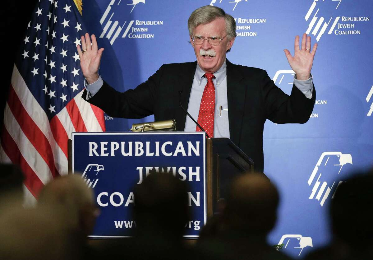 FILE - In this March 29, 2014, file photo, former U.S. ambassador to the U.N. John Bolton speaks at the Republican Jewish Coalition in Las Vegas. President Donald Trump?'s pick of Bolton for his next national security adviser stirred up the same burning question Friday in Washington as in anxious foreign capitals: Just how much will his hawkish, confrontational approach rub off on Trump? (AP Photo/Julie Jacobson, File)