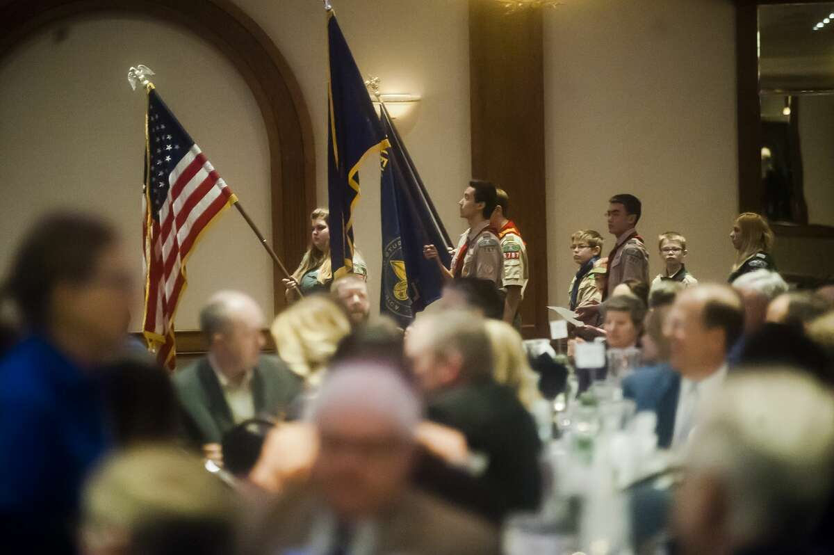Scouts from local troops perform the presentation of colors during the Great Lakes Bay Region Boy Scouts Breakfast on Monday, March 26, 2018 at the Great Hall Banquet and Convention Center. (Katy Kildee/kkildee@mdn.net)