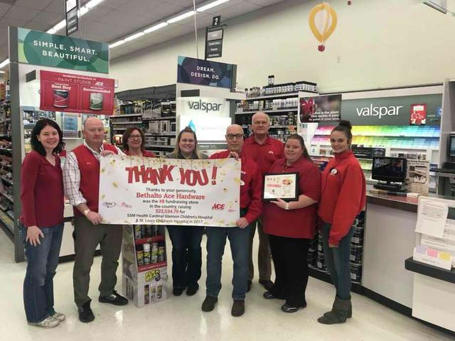 Bethalto Ace Hardware workers hold a sign thanking the community for helping them become the eighth-highest fundraising store in the country. The store raised more than $33,000 for area children's hospitals. Photo: For The Telegraph