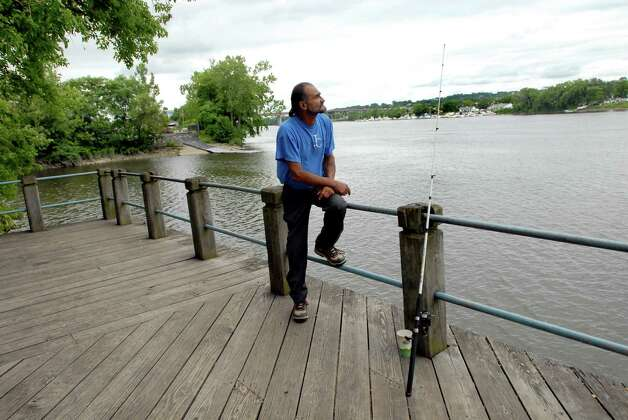 "Samuel ""Poppy"" Baez waits for a bite on July 24, 2009, at the Hudson River in Albany, N.Y. (Cindy Schultz / Times Union) Photo: CINDY SCHULTZ"
