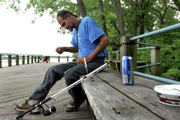 "Samuel ""Poppy"" Baez gets ready to fish on July 24, 2009, at the Hudson River in Albany, N.Y. (Cindy Schultz / Times Union) Photo: CINDY SCHULTZ"