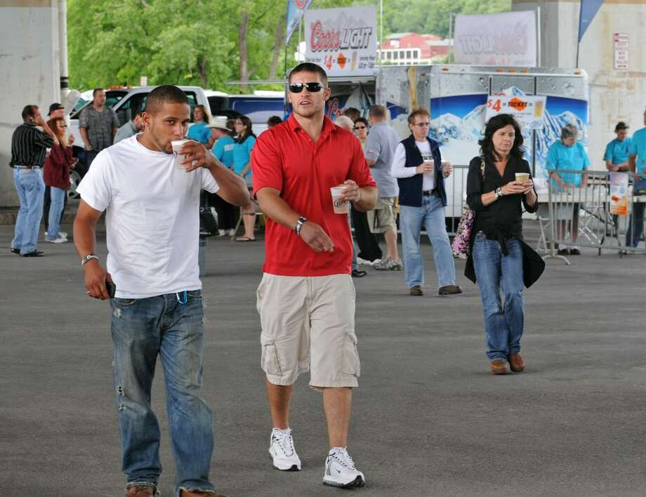 People buy beer at Alive at Five featuring Chubby Checker at the Corning Preserve rain location under I-787 in Albany, NY on June 10, 2010. (Lori Van Buren / Times Union) Photo: LORI VAN BUREN/TIMES UNION