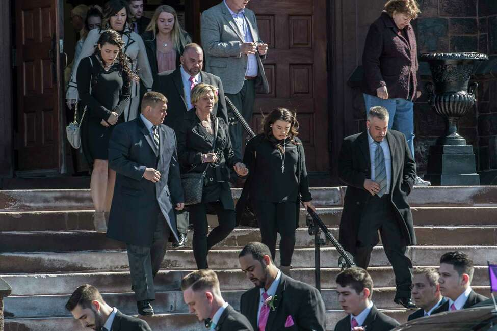Niko's mother, Alicia DiNovo, center follows the casket carrying the remains of her son Niko DiNovo as it is carried from Blessed Sacrament Church in Albany, N.Y. Monday March 16, 2018 after the funeral service for the crash victim. (Skip Dickstein/Times Union)