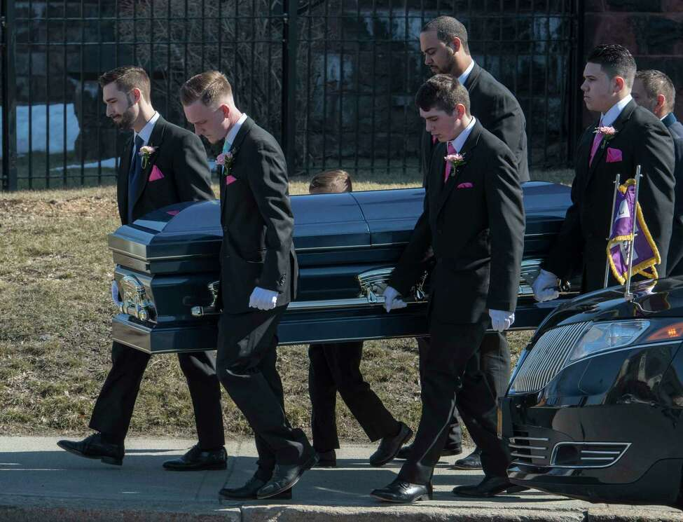 The casket carrying the remains of Niko DiNovo is carried from Blessed Sacrament Church in Albany, N.Y. Monday March 16, 2018 after the funeral service for the crash victim. (Skip Dickstein/Times Union)