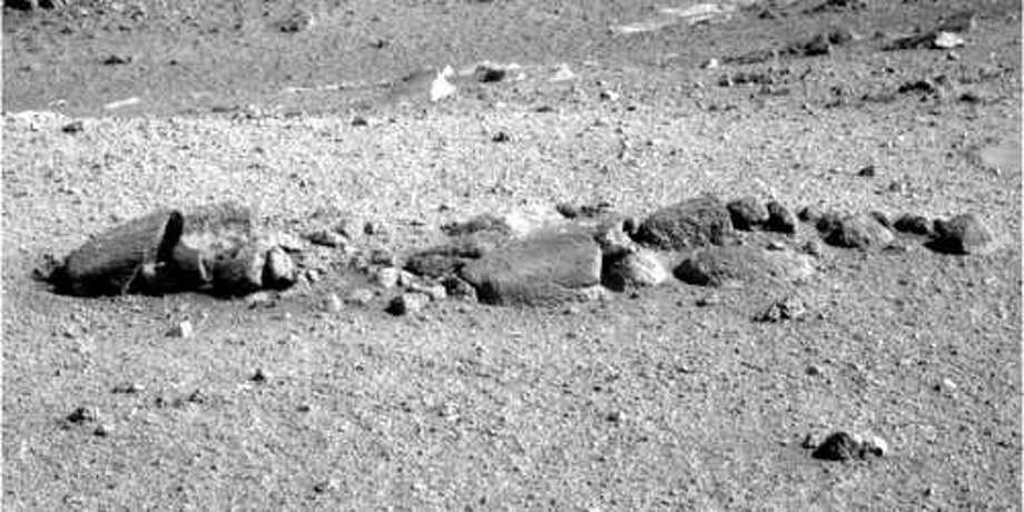 A space enthusiast in Waxahachie, Texas says he believes a group of apparent rocks is actually the skull and spine of a possible alien, according to a report filed with the Mutual UFO Network. The photo was taken by NASA's Opportunity rover on Feb. 1, 2018. Continue to see the other weird things spotted on Mars through the years.  Photo: Courtesy NASA/JPL-Caltech