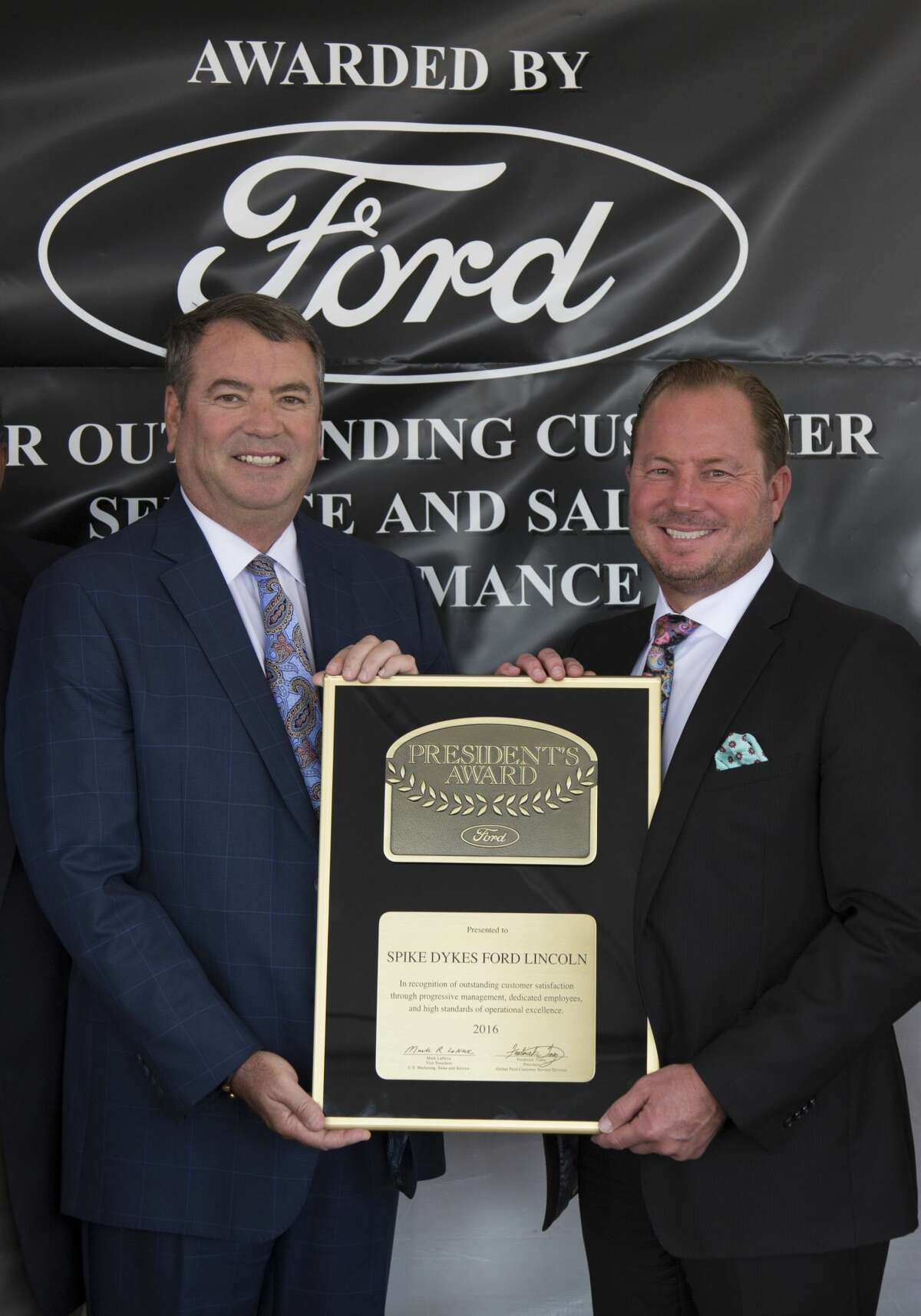 At left, Rick Dykes, Owner - Reagor Dykes Auto Group, and Bart Reagor, Owner, CEO - Reagor Dykes Auto Group, are shown at the 2016 Ford Presentation of President's Award to Spike Dykes Ford in Lamesa. In a new announcement Saturday, that same honor was bestowed on Plainview's Ford dealership. Besides being the first President's Award everfor Reagor Dykes Ford in Plainview, it also marked the first time both Reagor Dykes Ford dealerships were recognized in same year.