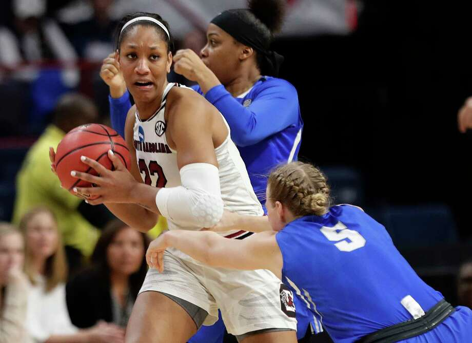 South Carolina's A'ja Wilson (22) looks to pass away from Buffalo's Katherine Ups (5) during the second half in a regional semifinal at the NCAA women's college basketball tournament Saturday, March 24, 2018, in Albany, N.Y. South Carolina won 79-63. (AP Photo/Frank Franklin II) Photo: Frank Franklin II, Associated Press / Copyright 2018 The Associated Press. All rights reserved.