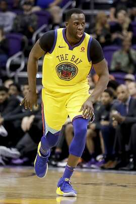 Golden State Warriors forward Draymond Green plays against the Phoenix Suns during an NBA basketball game in Phoenix, Sunday, March 18, 2018. (AP Photo/Chris Carlson)