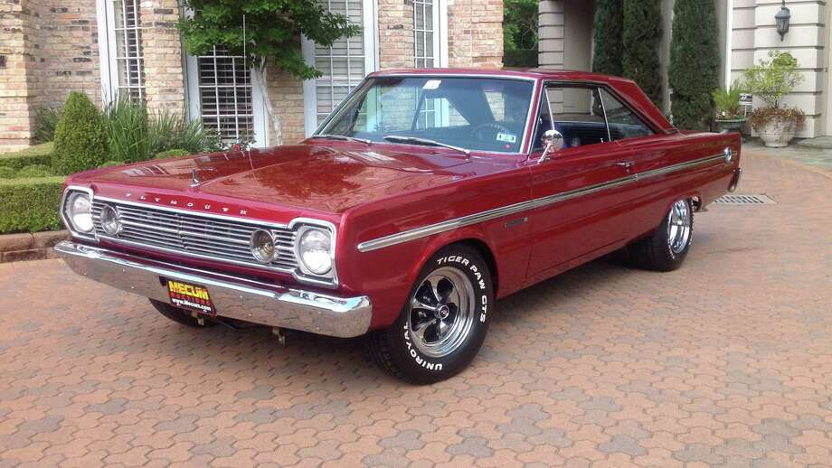 This 1966 Plymouth Belvedere (Lot F196) has a 425-horse 440 cu. in. V8, four-speed manual, air conditioning and old-school Keystone wheels. Photo: Courtesy Of Mecum Auction