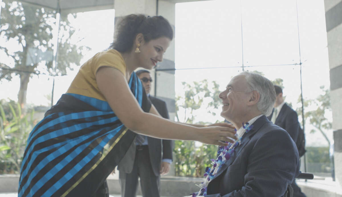 Texas Gov. Greg Abbott receives a garland in the lobby of the headquarters of the large Indian conglomerate, JSW Group, in Mumbai, India, on Monday, March 26, 2018.