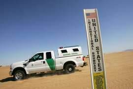 A border patrol vehicle passes an international border marker in the Colorado Desert at the Imperial Sand Dunes, also known as the Algodones Dunes, along the US-Mexico border on April 5, 2008 between El Centro, California and Yuma, Arizona. In an aggressive move to further extend walls and fences on the border with Mexico, the Bush administration will ignore more than 30 federal laws designed to protect the environment and cultural heritage in order to complete of 670 miles of barriers before the president leaves office. Congress has given US Department of Homeland Security (DHS) Secretary Michael Chertoff the power to waive the federal laws for rapid construction without delays for environmental impact studies and hearings. Two waivers allowing the DHS to ignore the laws are the most expansive to date, encompassing 470 miles of land across California, New Mexico, Arizona and Texas. Conservative Republicans are praising the time-saving tactic but wildlife and conservation groups are reacting with dismay that pristine natural lands, wildlife, and cultural sites could suffer without protective oversight. (Photo by David McNew/Getty Images)