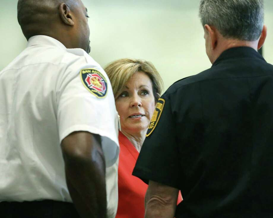 City Manager Sheryl Sculley, center, speaks with Police Chief William McManus, right, and Fire Chief Charles Hood, during a press conference concerning safety during the Final Four tournament, on Monday, March 26, 2018, at the Henry B. Gonzalez Convention Center. Photo: Bob Owen, Staff / San Antonio Express-News / ©2018 San Antonio Express-News