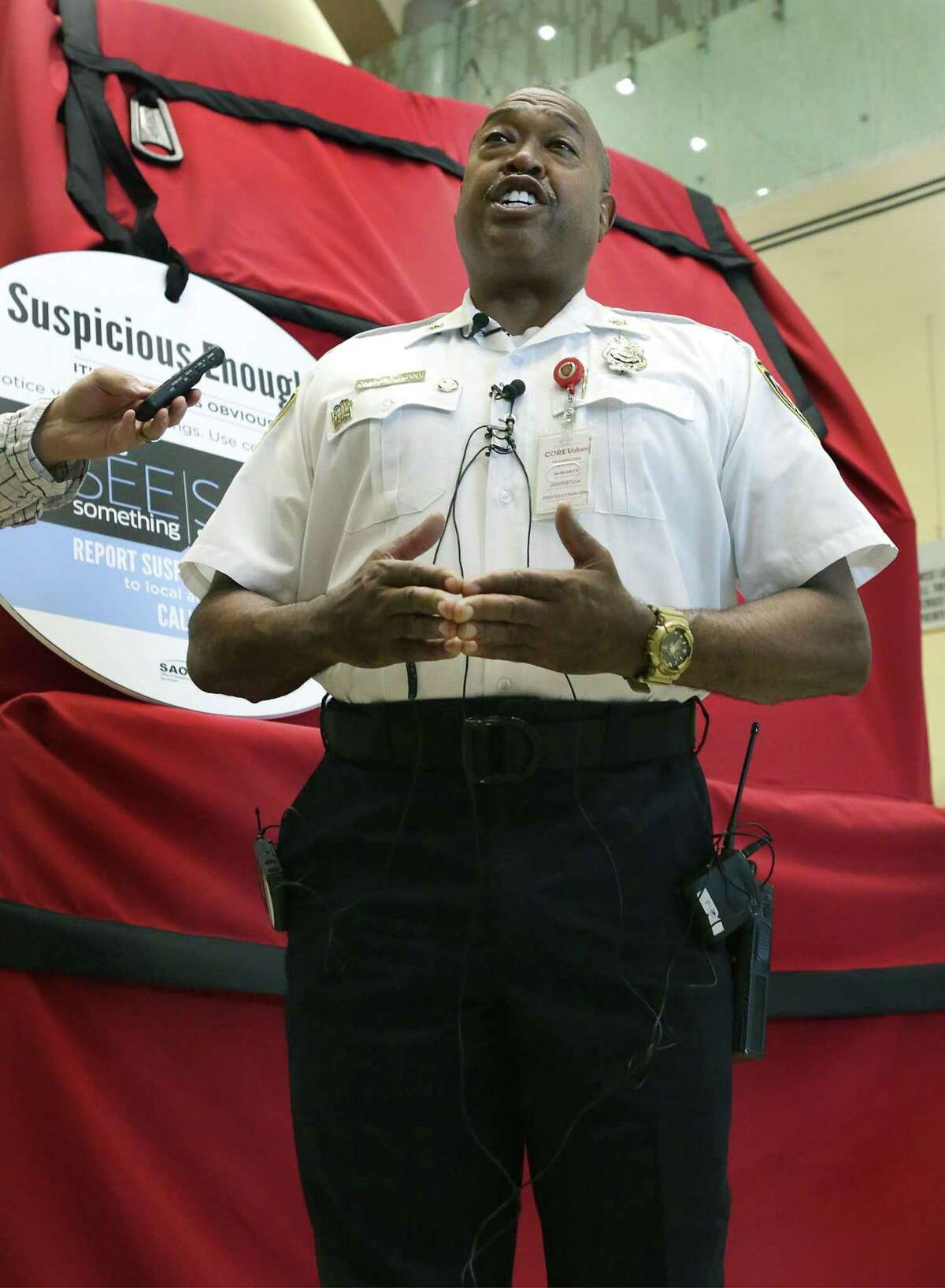 Fire Chief Charles Hood, standing in front of a giant backpack display, discusses safety issues during the upcoming Final Four, with the media during a press conference on Monday, March 26, 2018, at the Henry B. Gonzalez Convention Center.