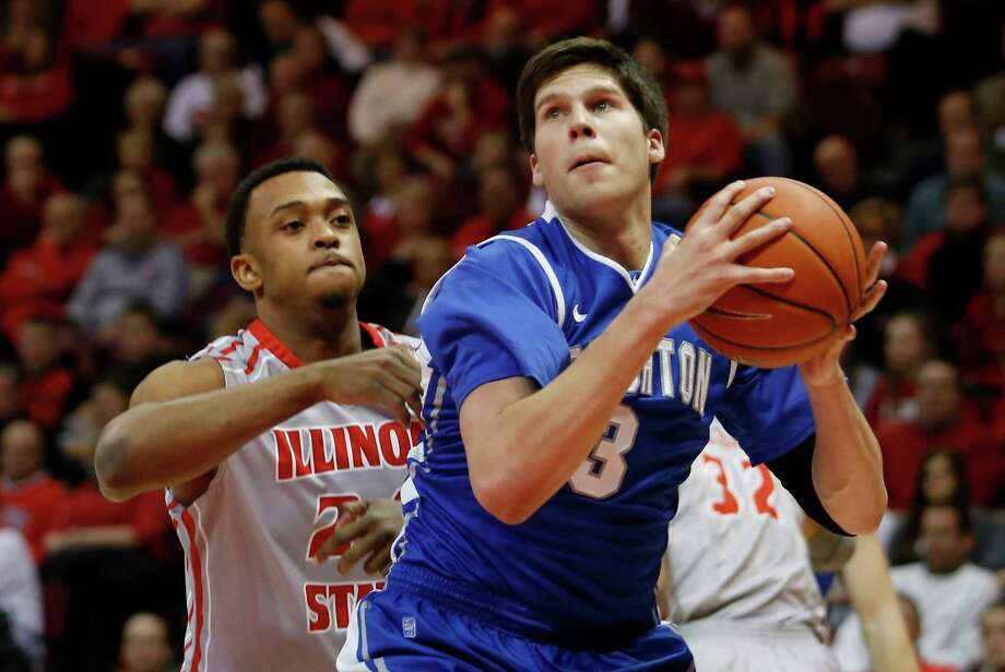 FILE - In this Jan. 2, 2013, file photo, Creighton's Doug McDermott (3) looks for room to shoot past Illinois State's Zeke Upshaw (24) during the first half of an NCAA college basketball game at Redbird Arena in Normal, Ill. Upshaw, the Detroit Pistons developmental player who collapsed on the court during a NBA G League game in Michigan has died. The Grand Rapids Drive says 26-year-old Upshaw died at a hospital Monday, March 26, 2018. No cause was disclosed. (AP Photo/ Stephen Haas, File) Photo: Stephen Haas, Associated Press / FR170194 AP