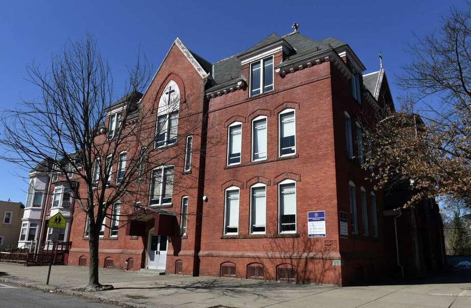 Exterior of the former St. Augustine's School on Monday, March 26, 2018, in the Lansingburgh neighborhood of Troy, N.Y.  The Diocese of Albany appears on the verge of selling property to a company that wants to remodel the building for apartment use.  (Will Waldron/Times Union) Photo: Will Waldron, Albany Times Union / 20043309A