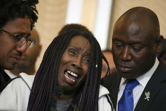 SACRAMENTO, CA - MARCH 26:  Sequita Thompson, (C) grandmother of Stephon Clark who was shot and killed by Sacramento police, cries during a news conference with civil rights attorney Ben Crump on March 26, 2018 in Sacramento, California. The family of Stephon Clark, an unarmed black man who was shot and killed by Sacramento police officers, have hired civil rights attorney Ben Crump to represent the Clark family in a wrongful death suit against the Sacramento police department. (Photo by Justin Sullivan/Getty Images) *** BESTPIX ***