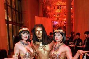"""Egyptian handmaidens and guard from J & D Entertainment, at the Houston Museum of Natural Science, and Board of Trustees """"Jewel of the Nile"""" gala."""