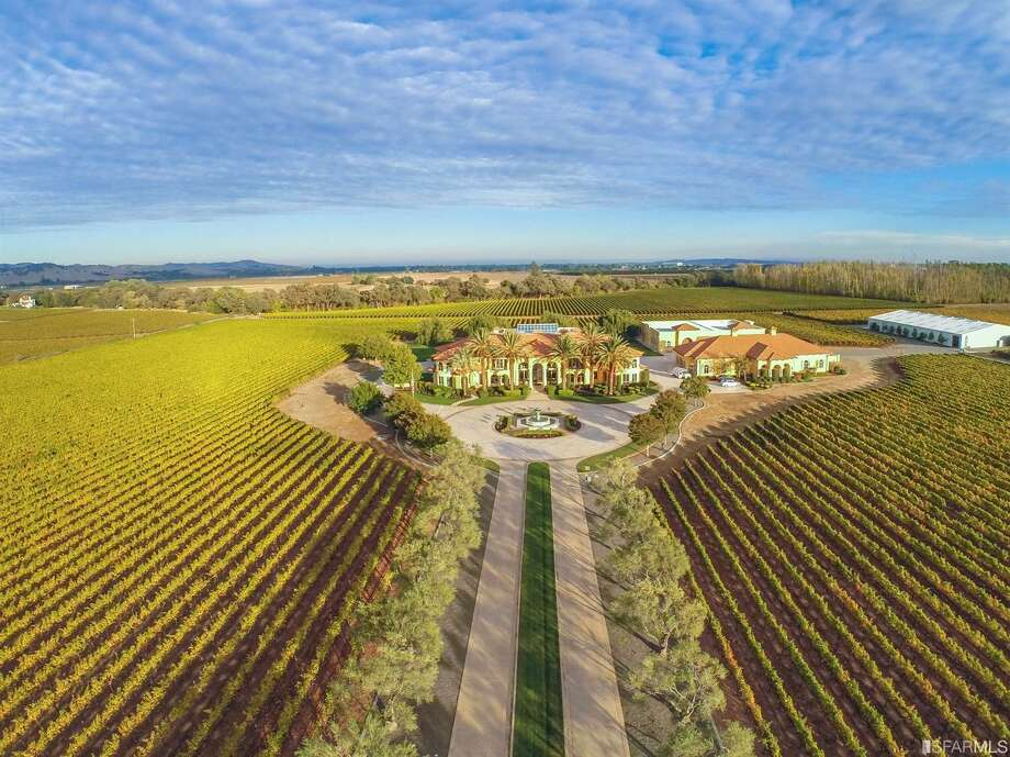 On 80 acres of fertile Fairfield land, Villa De Madre at 4286 Suisun Valley Rd. is listed for $12.9 million and features a custom-built estate, indoor pool, wine cave, elevation, four-bedroom caretaker's home and two car bars that can hold more than 100 cars. Photo: Darren Loveland