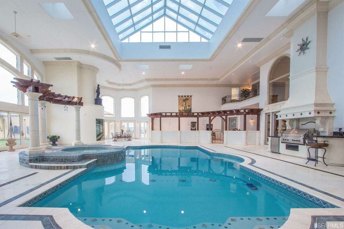 The home of the future may not have a sizable indoor pool like this property, but surveys show that more people will be incorporating wellness-facility amenities into their new homes in 2021. It's among the trends this year's pandemic has kicked into motion.