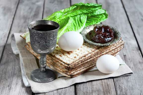 Wine, egg, bitter salad leaves, matzot and haroset are traditional Jewish Passover celebration elements.