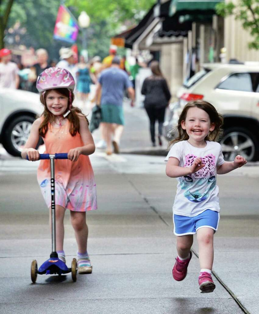Sisters Felicity,5, left, and Audrey Gotsch, 2,of Fairfield, Conn., enjoy the sidewalk scene along Broadway Saturday July 1, 2017 in Saratoga Springs, NY. (John Carl D'Annibale / Times Union)