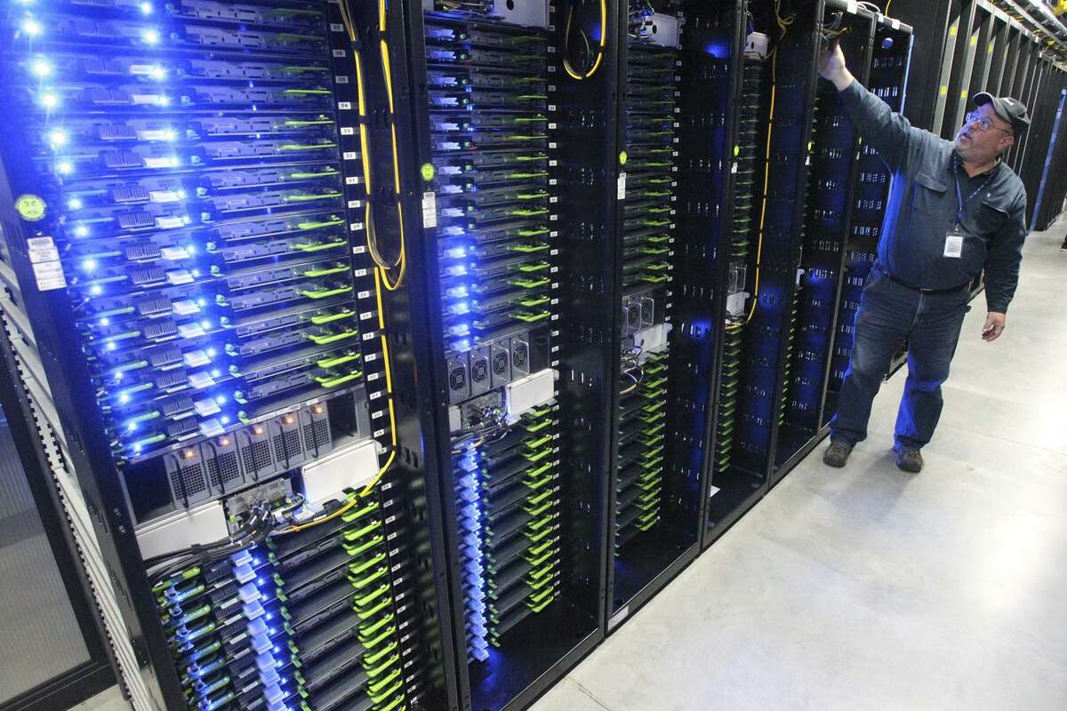 In this Oct. 15, 2013, photo, Chuck Goolsbee, site director for Facebook's Prineville data centers, shows the computer servers that store users' photos and other data, at the Facebook site in Prineville, Ore. Facebook frequently defends its data collection and sharing activities by noting that it's adhering to a privacy policy it shares with users.