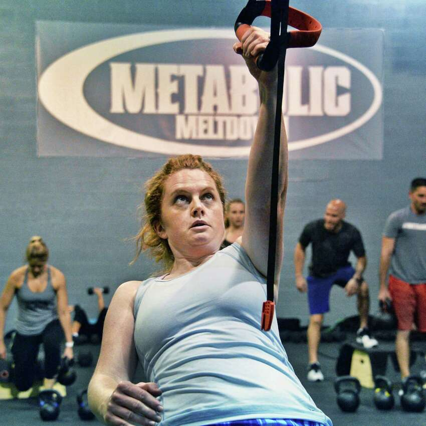 Times Union writer Leigh Hornbeck takes a class at Metabolic Meltdown Wednesday June 21, 2017 in Colonie, NY. (John Carl D'Annibale / Times Union)