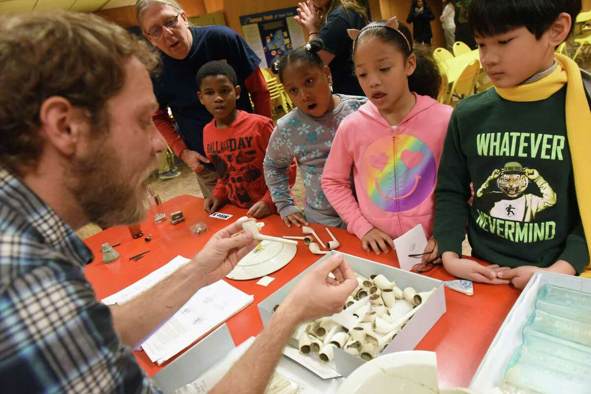 Muesum research and collection archaeologist Joshua Debuque works with Thomas O?'Brien Academy of Science and Technology third grade students during a a hands-on archaeology program at the New York State Museum on Friday Dec. 9, 2016 in Albany, N.Y. (Michael P. Farrell/Times Union)