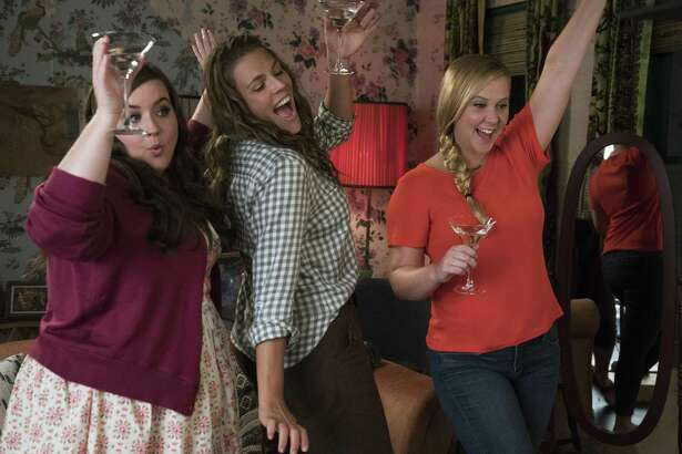 "Amy Schumer (right) jumps into the dating pool with friends Aidy Bryant (left) and Busy Philipps in ""I Feel Pretty."""