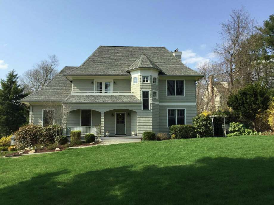The custom colonial house at 12 Calumet Road has 3,446 square feet of living space with nine rooms and four bedrooms.