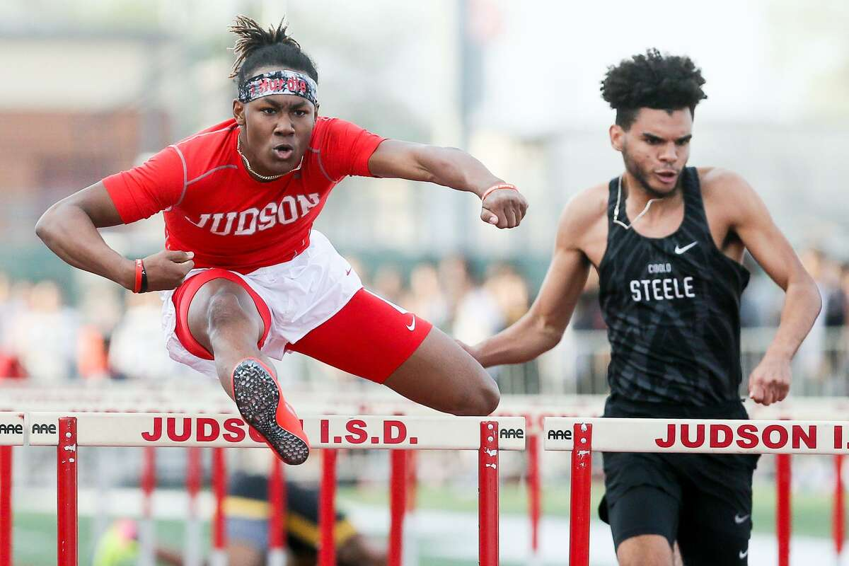 Judson's Trebien Gilbert (left), the Boys Athlete of the Year, won the 110- and 300-meter hurdles at the Class 6A track and field meet. He will compete for Arkansas.