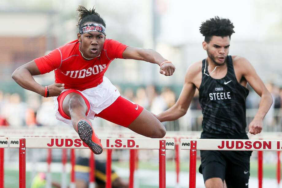 Judson's Trebien Gilbert (left) crosses the final hurdle in the boys 110-meter hurdles ahead of Steele's Ken Broadnax during the 2018 Judson Ron Faught Invitational at Rutledge Stadium on Thursday, March 1, 2018.  Gilbert won the event with a time of 14.23 seconds.  MARVIN PFEIFFER/mpfeiffer@express-news.net Photo: Marvin Pfeiffer, Staff / San Antonio Express-News / Express-News 2018