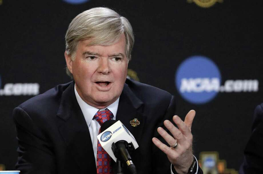 FILE - In this March 30, 2017, file photo, NCAA President Mark Emmert answers a question at a news conference in Glendale, Ariz. Emmert is hopeful the scandal roiling college basketball will lead to major rule changes, but schools paying players is likely a nonstarter. In a 45-minute phone interview with The Associated Press, Emmert said he expects a commission to reform college basketball to put forth proposals that could modernize NCAA rules on player-agent relationships, address the NBAs one-and-done rule and devise new ways to handle contentious and high-profile enforcement cases.  (AP Photo/David J. Phillip, File) Photo: David J. Phillip, STF / Associated Press / Copyright 2017 The Associated Press. All rights reserved.