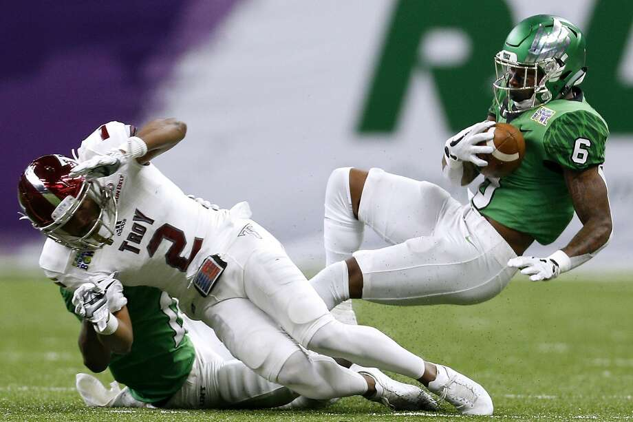 NEW ORLEANS, LA - DECEMBER 16:  Kishawn McClain #6 of the North Texas Mean Green intercepts a pass intended for John Johnson #2 of the Troy Trojans in the first half during the R+L Carriers New Orleans Bowl at the Mercedes-Benz Superdome on December 16, 2017 in New Orleans, Louisiana.  (Photo by Jonathan Bachman/Getty Images) Photo: Jonathan Bachman/Getty Images