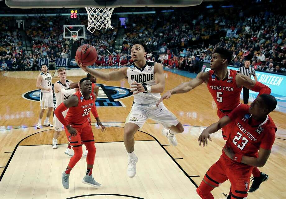 Purdue's Carsen Edwards (3) drives to the basket against Texas Tech's Norense Odiase (32), Justin Gray (5) and Jarrett Culver (23) during the second half of an NCAA men's college basketball tournament regional semifinal early Saturday, March 24, 2018, in Boston. (AP Photo/Charles Krupa) Photo: Charles Krupa, Associated Press / Copyright 2018 The Associated Press. All rights reserved.