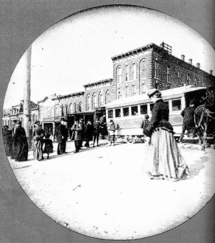 The fifth of December, 1867, brought a significant improvement to Alton. A mule-drawn streetcar made its first journey from City Hall downtown to College Avenue in Upper Alton. Cyrus Edwards of Upper Alton saw the need for public transportation to provide a link between the Altons. He interested other Upper Alton and Alton businessmen in the $100,000 venture. This scene shows the car at Broadway and Market. The former Barth Drug Store is in the background. Customers originally paid five cents for the trip. A horse car left downtown once every half hour. The horse trolley was the only public transportation for twenty-five years until the Alton Improvement Association put in a steam trolley. The photograph was taken with a camera, invented some time after 1880, that took round photographs. Photo: File Photo