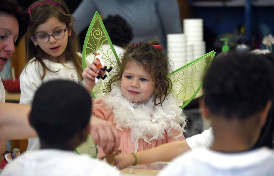 Dylan Raniola, a kindergarten student at Springdale School, dresses as the Fairy Godmother as she and her classmates participate in a a fairy-tale themed STEM festival on Friday, March 23, 2018 in Stamford. Connecticut. Children completed STEM (Science, technology, engineering and math)-related activities around a fairy tale theme such as planting beans like Jack and the Beanstalk and blowing houses down like the Big Bad Wolf. Photo: Matthew Brown / Hearst Connecticut Media / Stamford Advocate